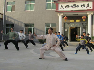 Chen Zhi Wei leading students in the school courtyard